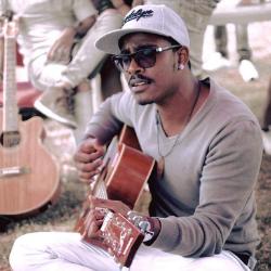 julien coosnapen, latet, mauritian artist, mauritius, guitarist, singer